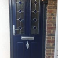 blue-composite-door-with-anthracite-grey-outerframe-installed-in-beare-green-by-dorking-glass