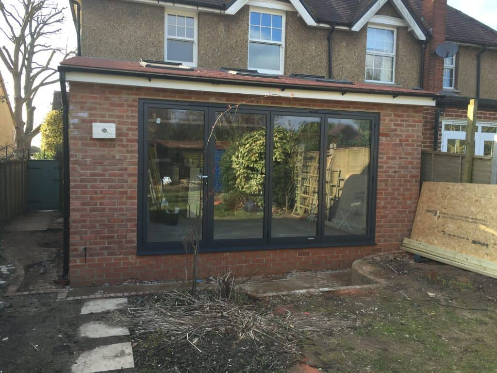 double-glazed-anthracite-grey-aluminium-bifolding-doors-by-dorking-glass