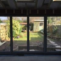 double-glazed-anthracite-grey-aluminium-bifolding-doors-by-dorking-glass-2