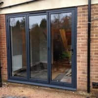 double-glazed-anthracite-grey-aluminium-bifolding-doors-by-dorking-glass-3