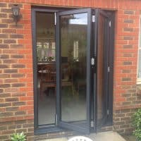 double-glazing-anthracite-grey-aluminium-bifolding-doors-in-brockham-dorking-glass