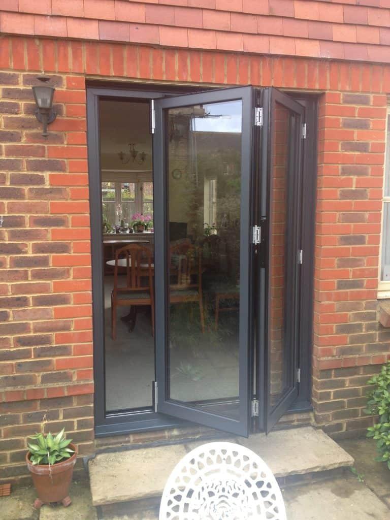 double-glazing-anthracite-grey-aluminium-bifolding-doors-in-brockham-dorking-glass