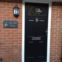 double-glazing-black-composite-front-door-in-dorking-glass