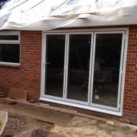 white-aluminium-double-glazed-aluminium-bifolding-doors-by-dorking-glass-in-surrey